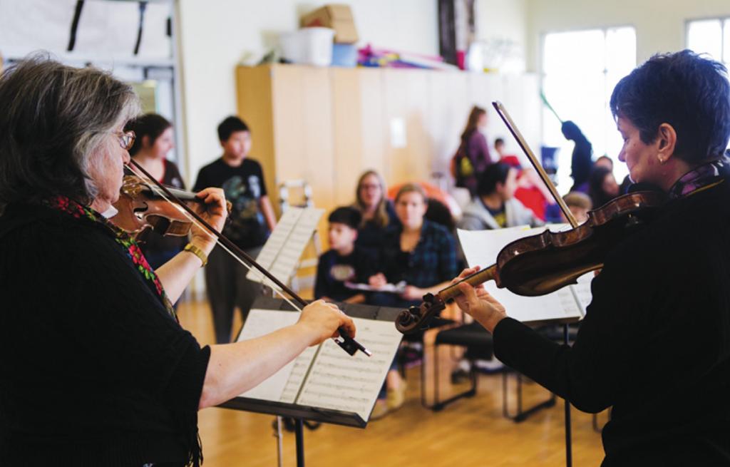 New Jersey Symphony musicians Susan Gellert (L) and Ann Kossakowski (R) perform at Eden Autism Services in Princeton, NJ