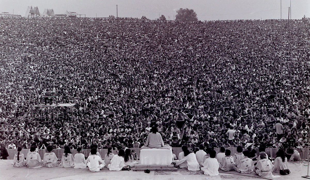 Opening ceremony at Woodstock. Swami Satchidananda giving the opening speech (photo: Wikipedia/Mark Goff)