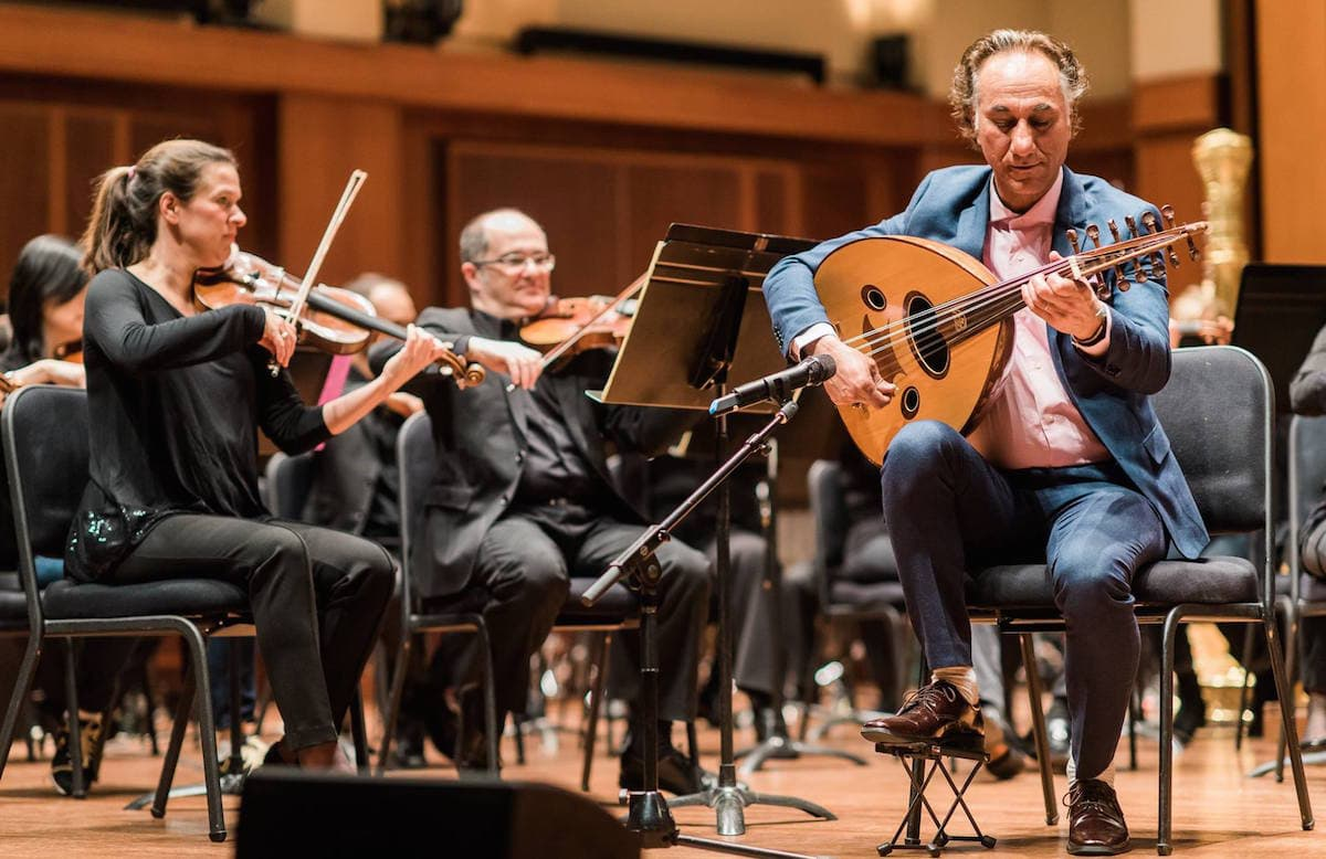 The Seattle Symphony performing with oud player Rahim Alhaj (Photo: Seattle Symphony/Facebook)