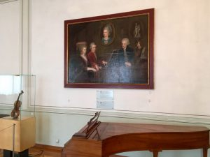 A family portrait hangs above Mozart's old harpsichord in the Mozart Residence