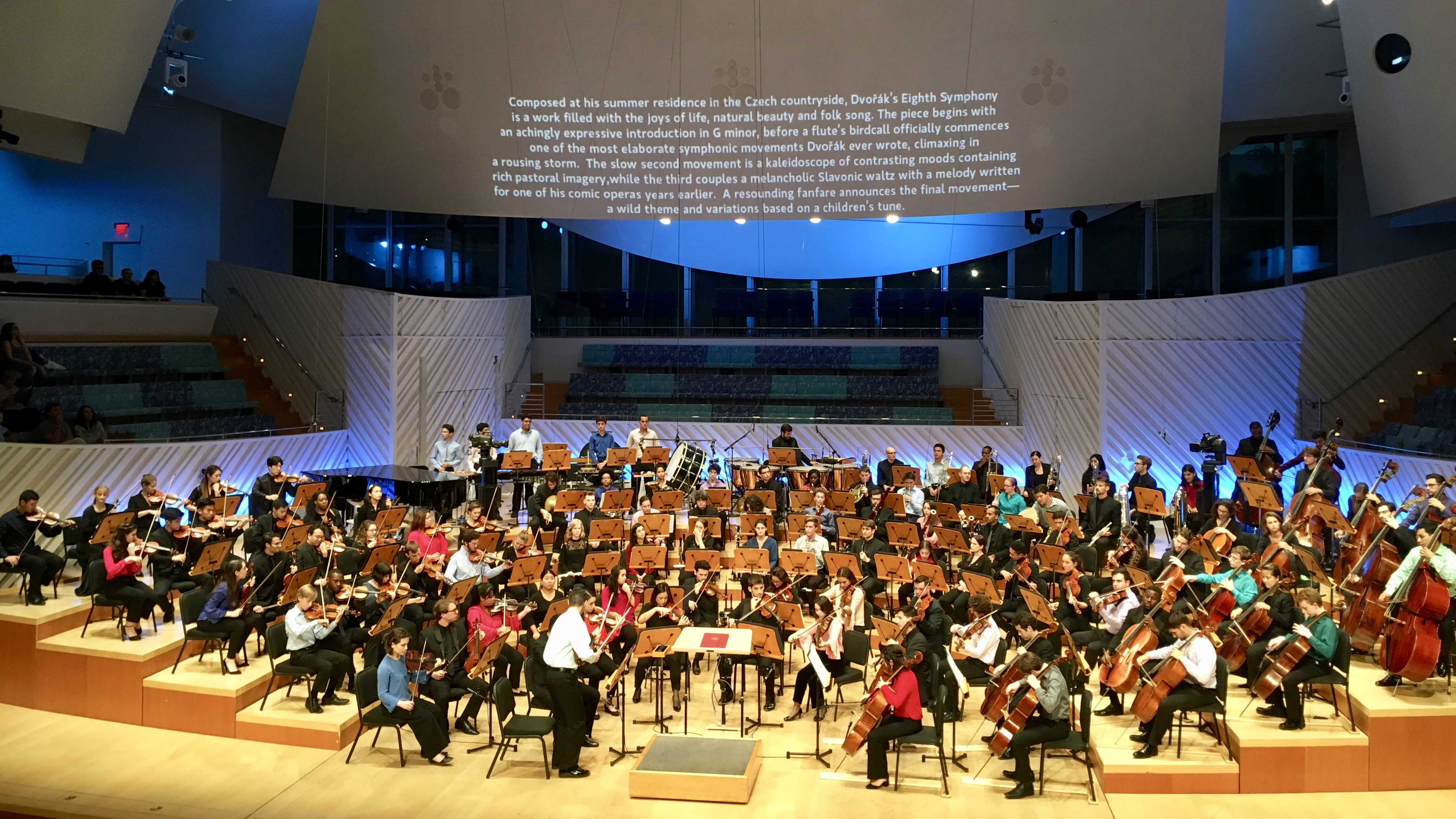 Notes for Dvorak's Eighth Symphony are projected above the New World Symphony musicians (photo: Brian Wise)