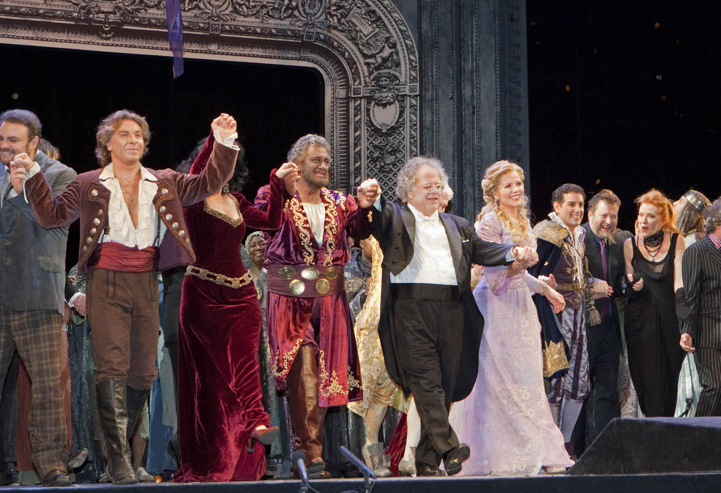 (from L to R) Roberto Alagna, Angela Gheorghiu (hidden), Placido Domingo, James Levine, Renee Fleming, Juan Diego Florez, Julian Crouch, and Catherine Zuber during the final bows following the Metropolitan Opera's 125th Anniversary Gala on March 15, 2009. Photo: Ken Howard/Metropolitan Opera Photo taken on March 15, 2009 at the Metropolitan Opera House in New York City.