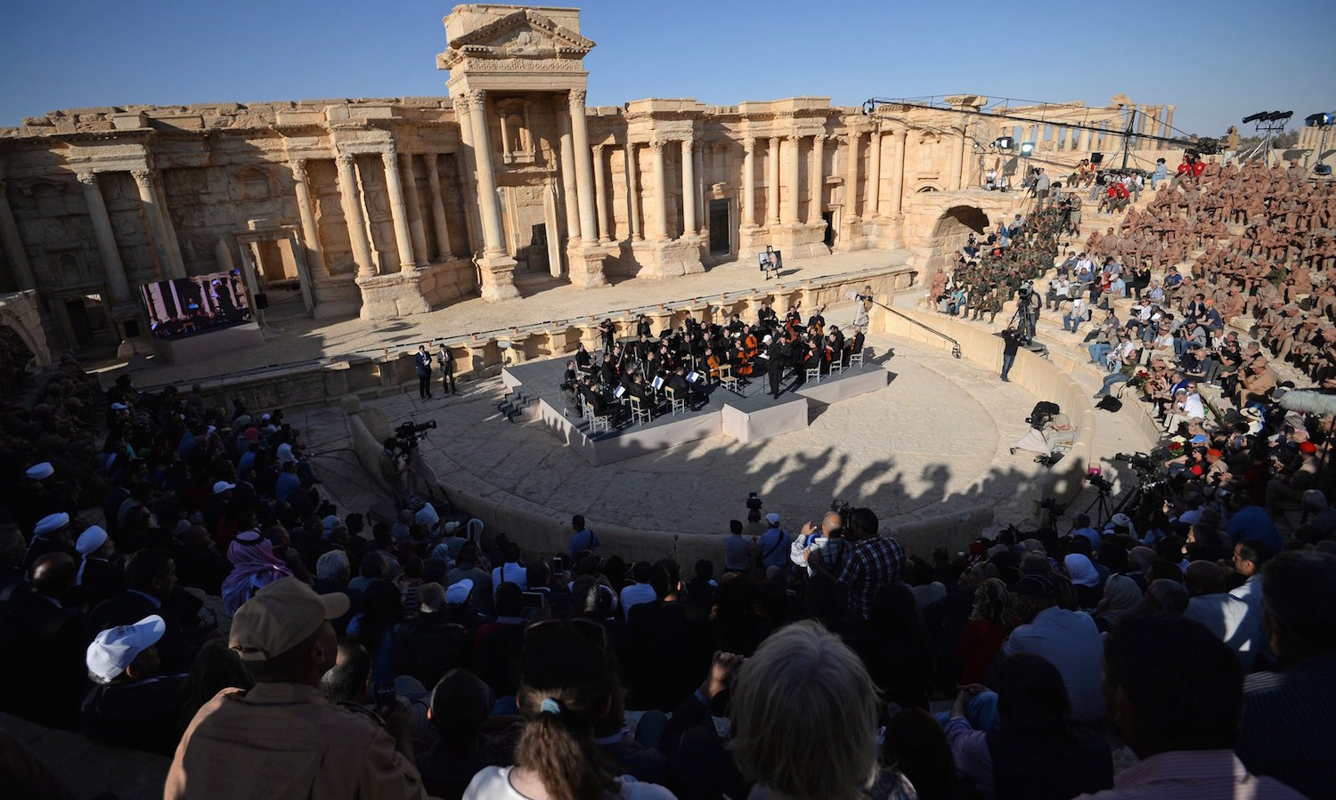 The Mariinsky Theater Orchestra, conducted by Valery Gergiev, performs in Palmyra, Syria in May 2016 (Kremlin image)