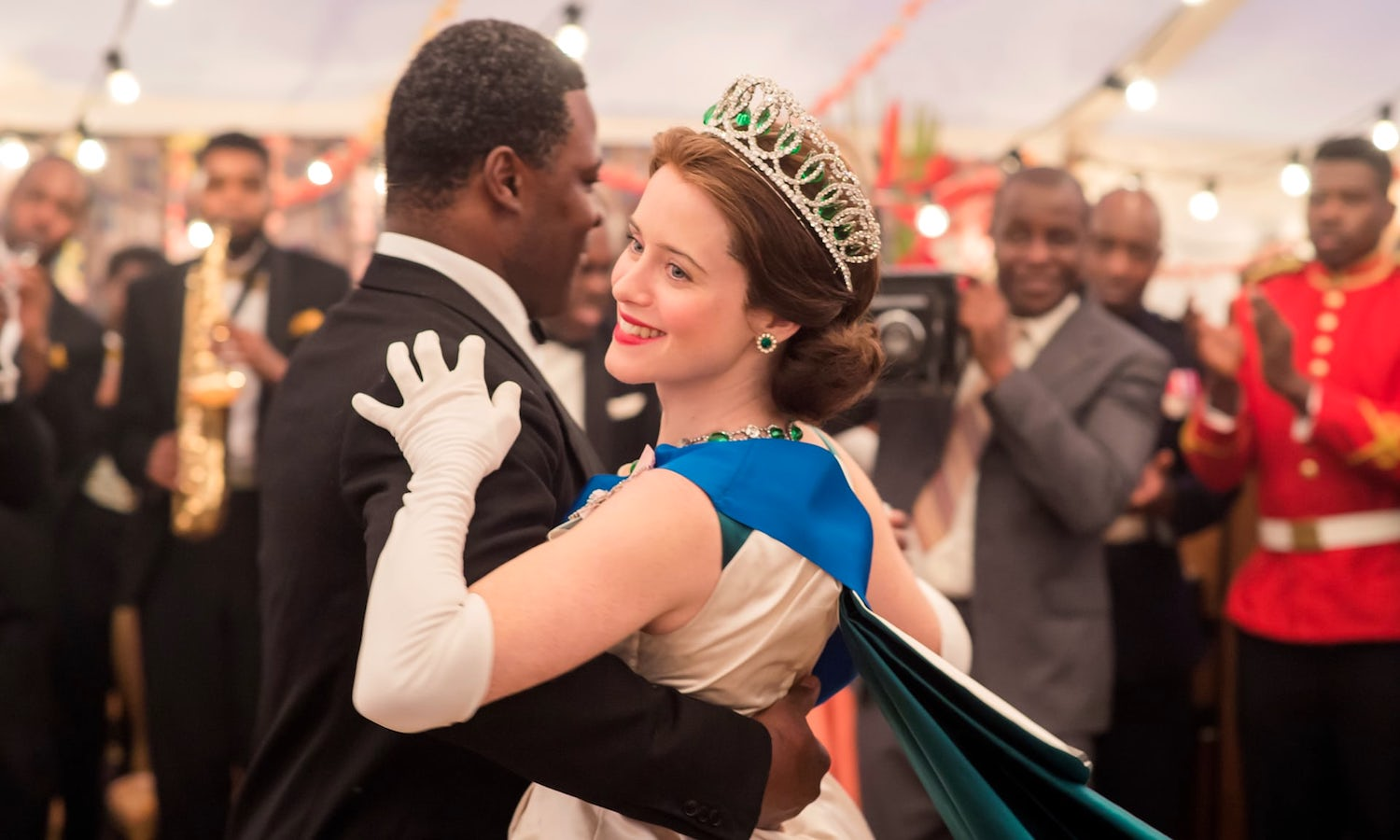 Queen Elizabeth (played by Claire Foy) and Kwame Nkrumah (Danny Sapani) dance in Ghana on the Netflix series, 'The Crown.'