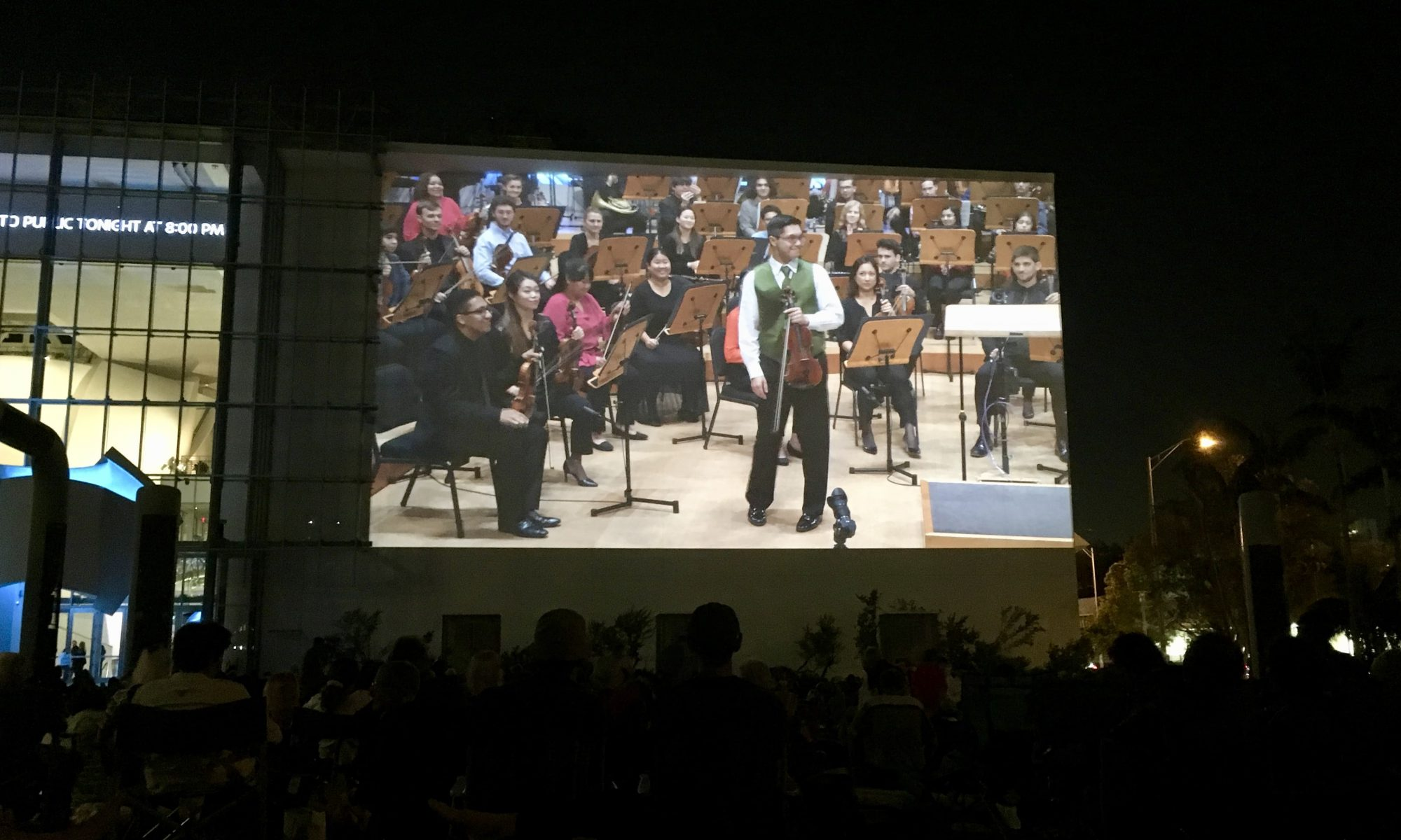 Violinist Matthew Hakkarainen performs with the New World Symphony, as seen on the outdoor Wallcast.
